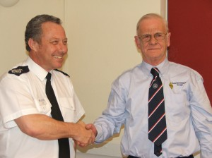 Chief Fire Officer Jon Hall and George Hayter from Gloucestershire RAYNET signing a Statement of Strategic Alliance